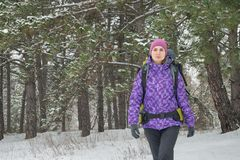Woman Hiking with Big Backpack in Beautiful Winter Forest Stock Image