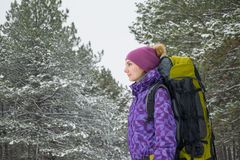 Woman Hiking with Big Backpack in Beautiful Winter Forest Royalty Free Stock Photos