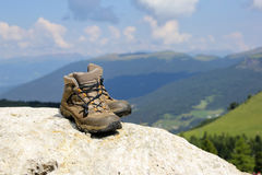 Woman hiking boots. At Alps mountain landscape background Royalty Free Stock Photography