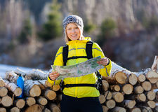 Woman hiking and camping in winter woods Royalty Free Stock Photo