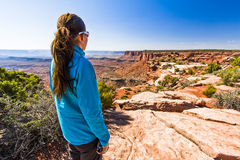 Woman Hiking in Canyonland's Desert Terrain Royalty Free Stock Photography