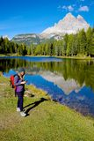 Woman while hiking checking map on cell phone Royalty Free Stock Images