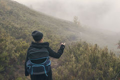 Woman hiking on a cloudy autumn day. Woman hiking with your pet on a cloudy autumn day Stock Images