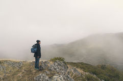 Woman hiking on a cloudy autumn day. Woman hiking with your pet on a cloudy autumn day Stock Photos
