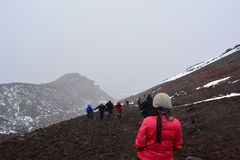 Woman hiking the Cotopaxi volcano near to Quito, Ecuador. An woman and other people doing the trekking to the top of Cotopaxi volcano in the snow stock images