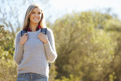 Woman Hiking In Countryside Wearing Backpack Royalty Free Stock Photos