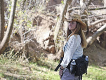A Woman Hiking in a Cowboy Hat Stock Image
