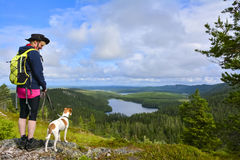 Woman hiking with dog Stock Photos