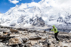 Woman hiking with Everest in background Royalty Free Stock Photos