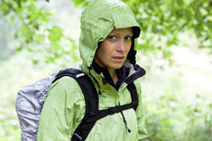 Woman hiking in forest Stock Image
