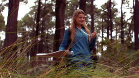 Woman hiking through a forest stock video footage