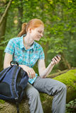 Woman Hiking with GPS Navigation Royalty Free Stock Photos