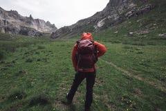Woman hiking on high altitude mountain. Female adventurer hiking on high altitude mountain Royalty Free Stock Photo
