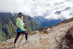 Woman hiking in Himalaya Mountains Royalty Free Stock Photo