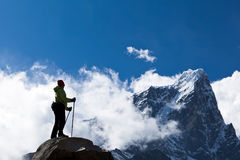 Woman hiking in Himalaya Mountains Stock Photo