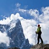 Woman hiking in Himalaya Mountains Royalty Free Stock Photo