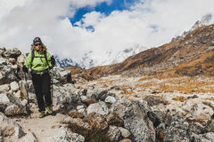 Woman hiking in Himalaya Mountains on Rocky Trail Royalty Free Stock Photos