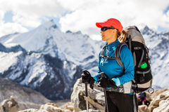 Woman hiking in Himalaya Mountains Royalty Free Stock Images