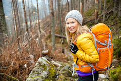 Woman Hiking In Autumn Forest Trail Stock Photo