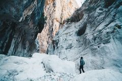 Woman hiking insdide the deepest canyon in Europe - Activity and. Health concept - Gola Su Gorroppu Stock Photo