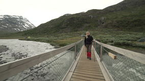 Woman hiking in Jotunheimen National Park, Norway stock footage