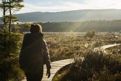 Woman hiking at Kepler track Stock Photos