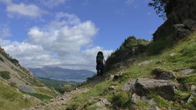 Woman hiking in Lake District stock footage