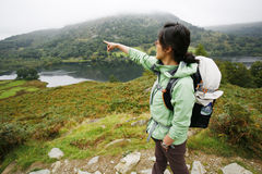 Woman hiking in Lake District Stock Photography