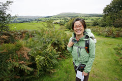 Woman hiking in Lake District Stock Photo