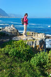 Woman hiking and looking at beautiful ocean view Royalty Free Stock Photos