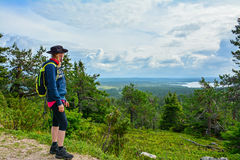 Woman hiking in mountain. Area Royalty Free Stock Images