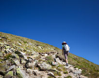 Woman hiking, on mountain trail Stock Photography