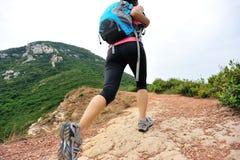 Woman Hiking on mountain Stock Photo