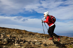 Woman hiking in mountains Stock Photo