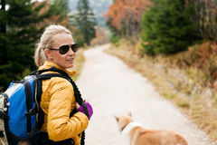 Woman hiking in mountains Stock Photography