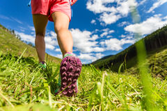 Woman hiking in mountains, adventure and travel Stock Photo