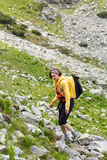 Woman hiking into the mountains Stock Image