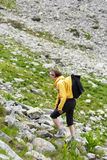 Woman hiking into the mountains Royalty Free Stock Photo
