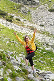 Woman hiking into the mountains Royalty Free Stock Photos