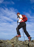 Woman hiking in mountains, nordic walking Royalty Free Stock Photo