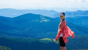 Woman hiking in mountains at sunny day stock images