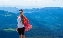 Woman hiking in mountains at sunny day stock image