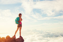 Woman Hiking in the Mountains at Sunset Royalty Free Stock Image