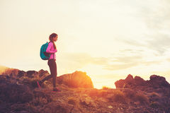 Woman Hiking in the Mountains at Sunset Royalty Free Stock Photos