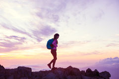Woman Hiking in the Mountains at Sunset Stock Photography
