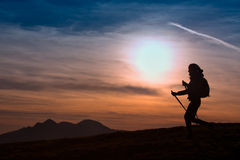 Woman Hiking in the Mountains at Sunset  Outdoor Adventure  Acti Royalty Free Stock Photography