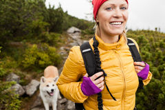 Woman hiking in mountains, trekking in nature Royalty Free Stock Photos