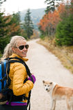 Woman hiking in mountains, trekking in nature Royalty Free Stock Image