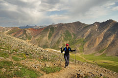 Woman Hiking In Mountains Royalty Free Stock Photography