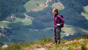 Woman Hiking in the Mountains Stock Photos